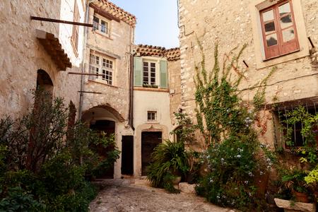 Photo pour facades of ancient stone buildings at old european town, Antibes, France - image libre de droit