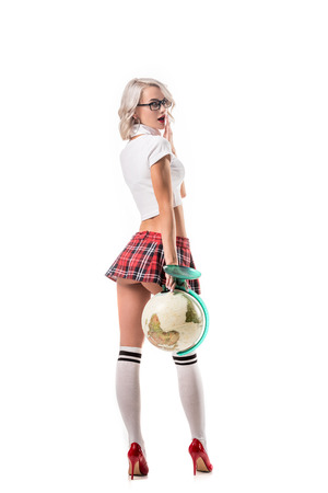Photo pour sexy blond woman in eyeglasses and college uniform holding globe isolated on white - image libre de droit