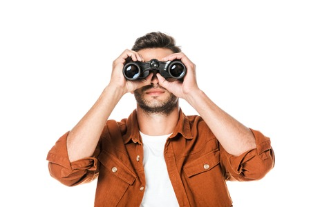 Photo pour handsome young man looking at camera with binoculars isolated on white - image libre de droit