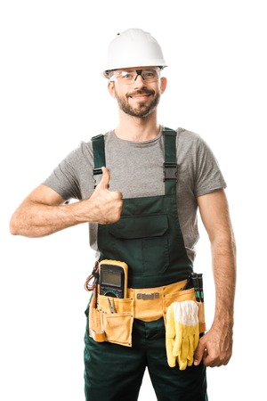 Foto de smiling handsome electrician showing thumb up isolated on white - Imagen libre de derechos