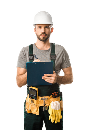 Foto de handsome electrician holding clipboard and looking at camera isolated on white - Imagen libre de derechos