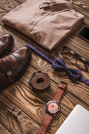 Foto de close up view of fashionable male clothing, accessories and digital devices on wooden surface - Imagen libre de derechos