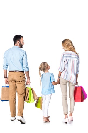 Photo pour back view of family with shopping bags isolated on white - image libre de droit