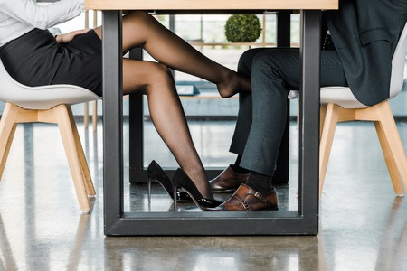 Photo for cropped shot of businesswoman flirting with businessman during work in office - Royalty Free Image