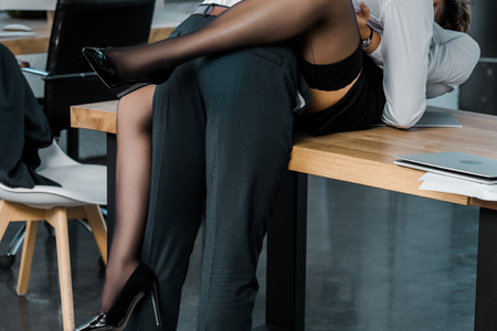 Foto de cropped shot of passionate sexy businesswoman and businessman at workplace in office - Imagen libre de derechos