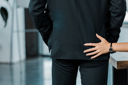 Photo for cropped shot of businesswoman flirting with colleague in office - Royalty Free Image