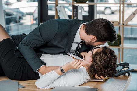 Photo pour passionate businessman and businesswoman at workplace in office - image libre de droit