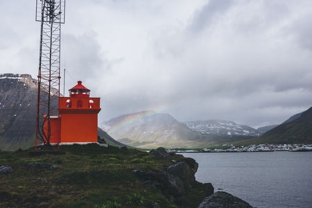 Foto de lighthouse on cliff with rainbow on background in Iceland - Imagen libre de derechos
