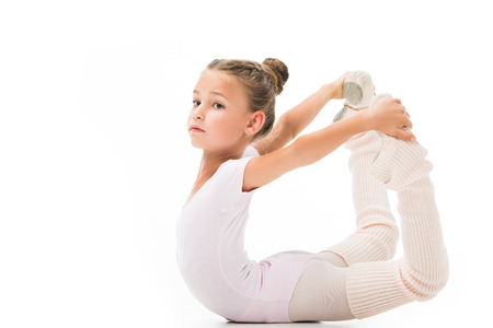 Photo pour Beautiful little child doing gymnastics exercises isolated on white background - image libre de droit