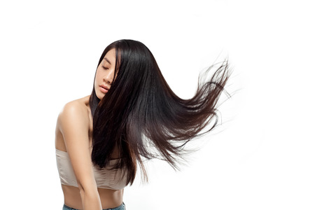 Foto de Portrait of young asian woman with beautiful and healthy hair isolated on white - Imagen libre de derechos