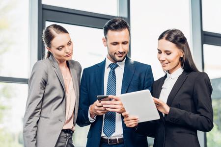 Photo pour portrait of businessman and businesswomen using tablet in conference hall - image libre de droit
