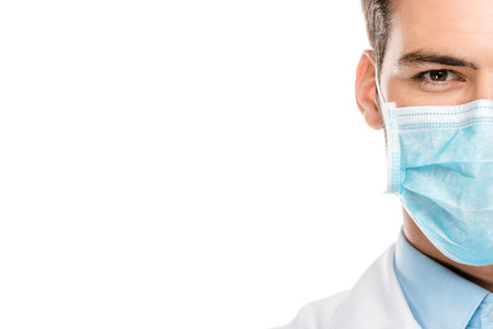 Foto de Cropped image of young male doctor in medical mask isolated on white background - Imagen libre de derechos