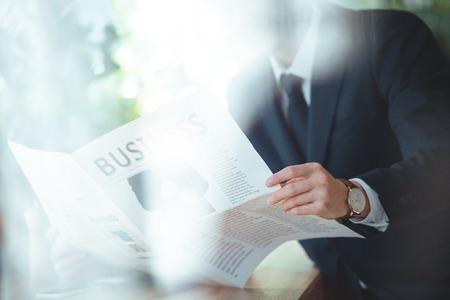 Foto de Partial view of businessman with newspaper in cafe - Imagen libre de derechos
