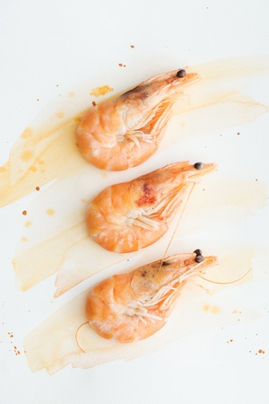 Photo for top view of tasty prawns on white tabletop with watercolor strokes - Royalty Free Image