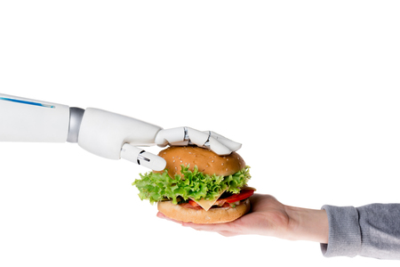 Photo pour Cropped shot of robot passing tasty burger to human isolated on white background - image libre de droit