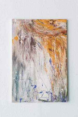 Foto de Abstract painting in bright color spots hanging on a wall - Imagen libre de derechos