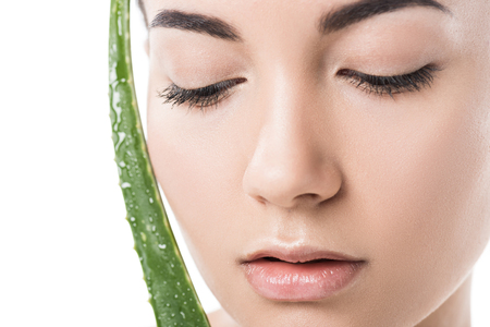 Photo pour headshot of beautiful girl touching face with aloe vera leaf isolated on white - image libre de droit