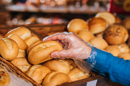 Photo for partial view of shopper taking loaf of bread in grocery shop - Royalty Free Image