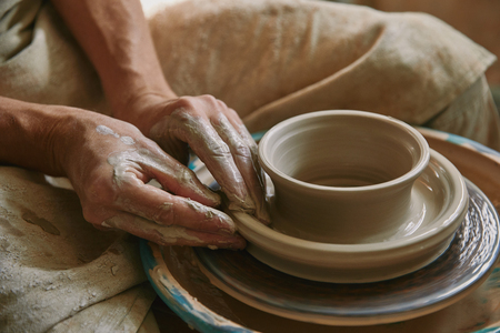 Photo for Close up view of professional potter working on pottery wheel at workshop - Royalty Free Image