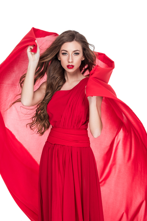 Photo for Beautiful woman posing with red chiffon veil, isolated on white background - Royalty Free Image