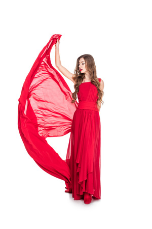 Photo for Glamorous girl posing in red dress with veil, isolated on white background - Royalty Free Image