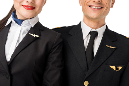 Photo pour Close-up view of stewardess and pilot in uniform isolated on white background - image libre de droit