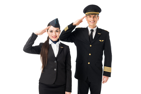 Photo pour Young stewardess and pilot saluting isolated on white background - image libre de droit