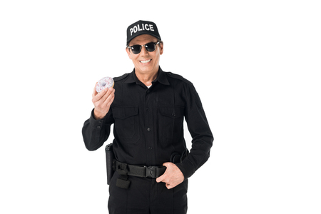 Foto de Smiling policeman holding doughnut isolated on white background - Imagen libre de derechos