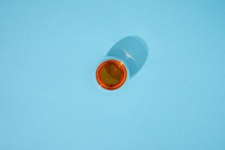 Foto de Top view of glass cup with fresh hot tea on blue background - Imagen libre de derechos