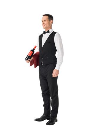 Photo pour Male waiter serving bottle with wine isolated on white background - image libre de droit