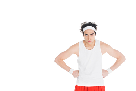 Photo pour Thin serious sportsman with hands on waist isolated on white background - image libre de droit