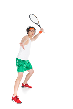 Photo pour Thin sportsman in headband standing with racket isolated on white background - image libre de droit