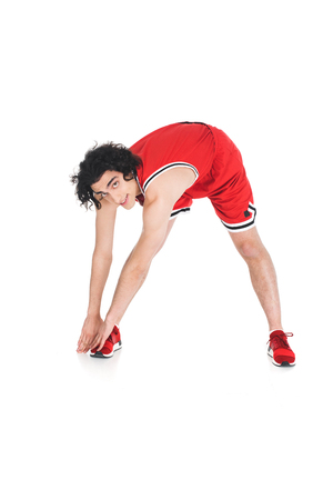 Photo pour Young skinny sportsman doing exercise isolated on white background - image libre de droit