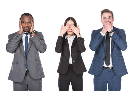 Foto de Portrait of multicultural young business people covering parts of faces isolated on white background - Imagen libre de derechos