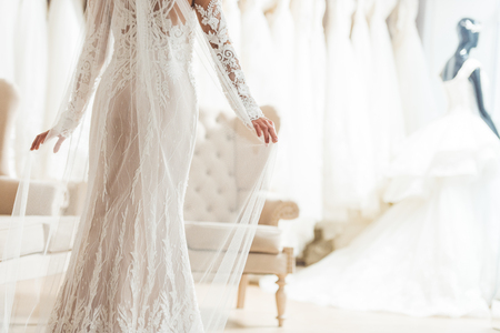 Foto de Cropped view of bride in lace dress in wedding salon - Imagen libre de derechos