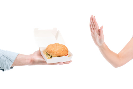 Photo pour cropped image of woman rejecting unhealthy burger isolated on white - image libre de droit