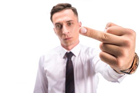 Foto de selective focus of angry businessman showing middle finger isolated on white - Imagen libre de derechos