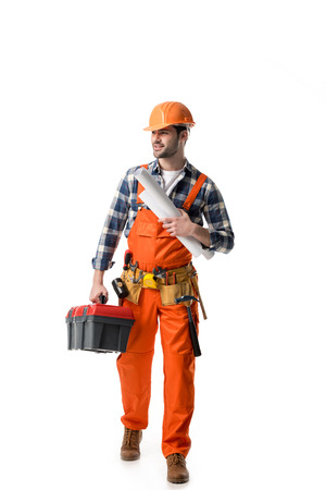 Foto de workman in orange overall holding tool box and blueprint isolated on white - Imagen libre de derechos