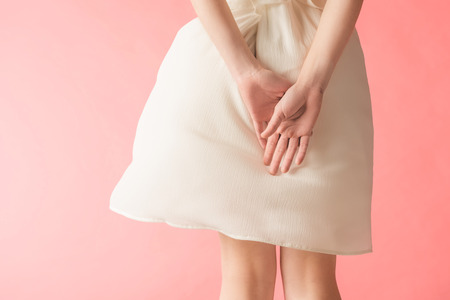Photo for midsection view of woman posing in elegant white dress, isolated on pink - Royalty Free Image