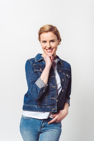 Foto de portrait of beautiful smiling woman in denim clothing looking at camera isolated on grey - Imagen libre de derechos