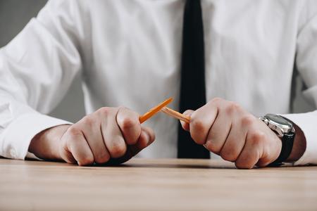 Photo pour cropped shot of businessman holding broken pencil in hands - image libre de droit