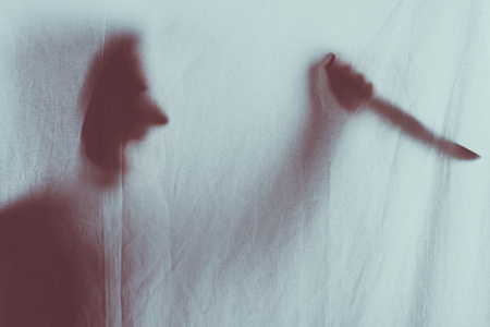 Photo for scary blurry silhouette of person screaming and holding knife behind veil - Royalty Free Image