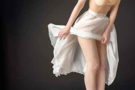 Photo for cropped view of sensual girl posing in elegant chiffon skirt, isolated on grey - Royalty Free Image