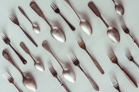 Photo for Vintage spoons and forks on white table - Royalty Free Image