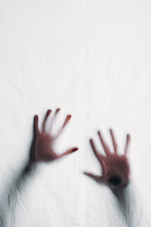 Photo for blurry silhouette of human hands touching frosted glass - Royalty Free Image