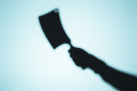 Photo for scary blurry shadow of person holding meat knife on blue - Royalty Free Image