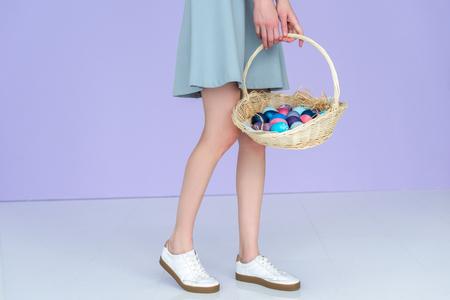 Foto de Cropped view of woman holding painted Easter eggs - Imagen libre de derechos