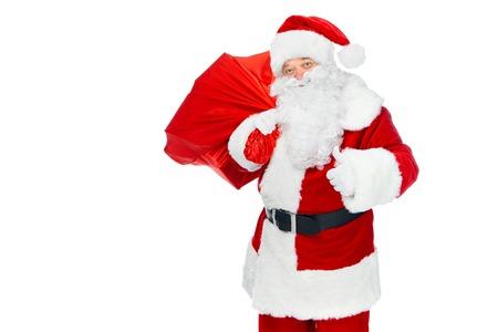 Foto de happy santa claus with christmas bag showing thumb up isolated on white - Imagen libre de derechos
