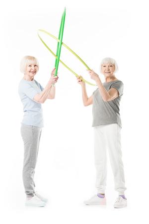 Photo pour Senior sportswomen holding toy isolated on white - image libre de droit