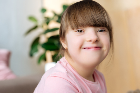 Foto de Portrait of smiling kid with down syndrome - Imagen libre de derechos